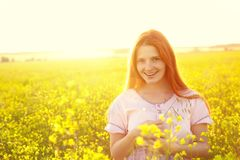 Redhead woman outdoors. stylish romantic young girl on nature background. yellow field stock image