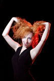 Redhead woman play the fool Stock Photos
