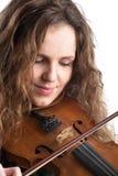 Redhead woman play violin Stock Photo