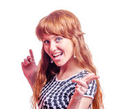 Redhead woman pointing Royalty Free Stock Images