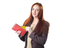 Redhead woman pulling credit card out of a red purse Royalty Free Stock Photos