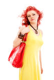 Redhead woman with red bag Stock Images