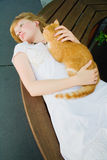 Redhead woman with red cat Royalty Free Stock Photo