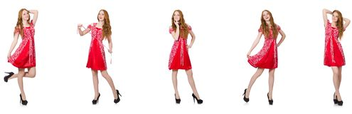 The redhead woman in red dress royalty free stock photos
