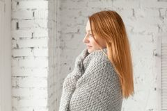 Redhead Woman Relaxing at Home in Cozy Winter Stock Photos