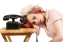 Redhead woman with a retro look waiting for the phone Stock Photos