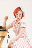 Redhead woman with a retro look waiting for the phone Stock Images