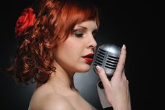 redhead woman with retro microphone Royalty Free Stock Photo