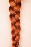 Redhead Woman`s Braid Stock Photo