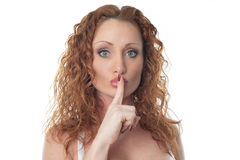 Redhead woman saying Shh Royalty Free Stock Photography