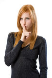 Redhead woman says hush Stock Images