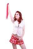 Redhead woman in schoolgirl outfit holding tie Royalty Free Stock Photo
