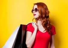 Redhead woman with shopping bags Stock Photo
