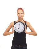 A redhead woman showing the time on the clock Stock Photos