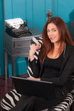 Redhead Woman Sitting Office Setting Working Computer Laptop Royalty Free Stock Image