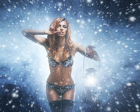 A redhead woman on a snowy background with a lantern Royalty Free Stock Image