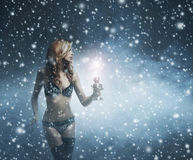 A redhead woman on a snowy background with a lantern Royalty Free Stock Photo