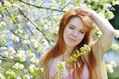 Redhead woman in spring Stock Image