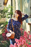 Redhead woman in spring Royalty Free Stock Image
