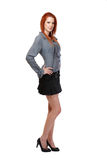 Redhead woman standing in studio Stock Photo