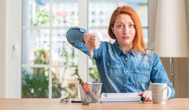Young beautiful redhead woman at home royalty free stock photography