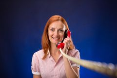 Redhead woman with telephone Royalty Free Stock Photography