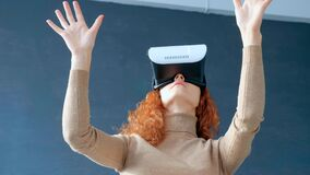 Redhead woman with virtual reality glasses.  stock video footage