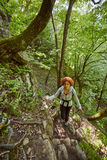 Redhead woman walking on a mountain trail Stock Images