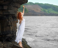 Redhead woman in white dress. Royalty Free Stock Photography