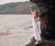 Redhead woman in a white dress. royalty free stock image