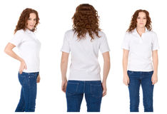 Redhead woman in white polo shirt and jeans Stock Photo
