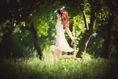 Redhead woman in the wood Royalty Free Stock Photos