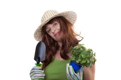 Redhead woman working in the garden Stock Photo