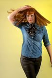 Redhead woman yellow background stock photos