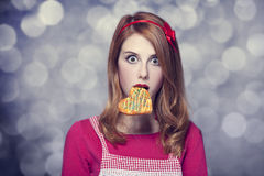 Redhead women with cookie Stock Photography