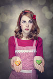 Redhead women with cookies Royalty Free Stock Photo
