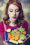 Redhead women with cookies Stock Images