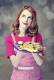 Redhead women with cookies Royalty Free Stock Photos