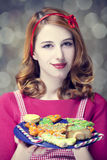 Redhead women with cookies Royalty Free Stock Images