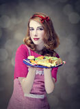 Redhead women with cookies Stock Photos