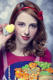 Redhead women with cookies Stock Image