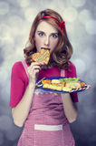 Redhead women with cookies Stock Photography