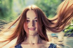 Redhead women with her long hair flying in the air by wind Royalty Free Stock Photography