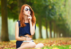Redhead women near bike Royalty Free Stock Image