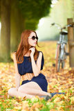 Redhead women near bike Stock Photography
