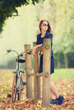Redhead women near bike Royalty Free Stock Photos