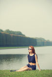 Redhead women near lake Stock Images