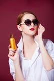 Redhead women perfume Stock Photo
