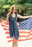 Redhead women posing with US flag Stock Image