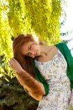 Redhead y viento Foto de archivo